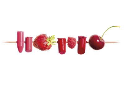 Red lipsticks and red fruits